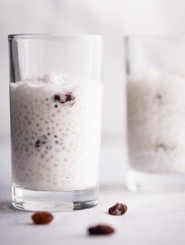 glass of tapioca vegan coconut rum raisin pudding on white background