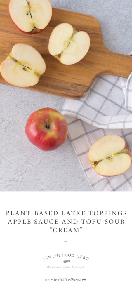 Apples on wooden cutting board