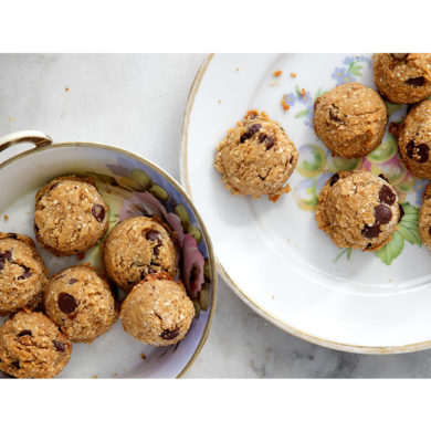 Vegan Nutty Chocolate Chip Cookies in floral bowl on marble table
