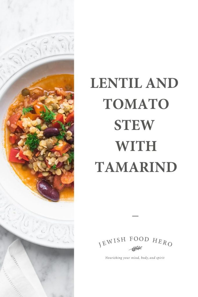while bowl full of Lentil and Tomato Stew with Tamarind on white table cloth