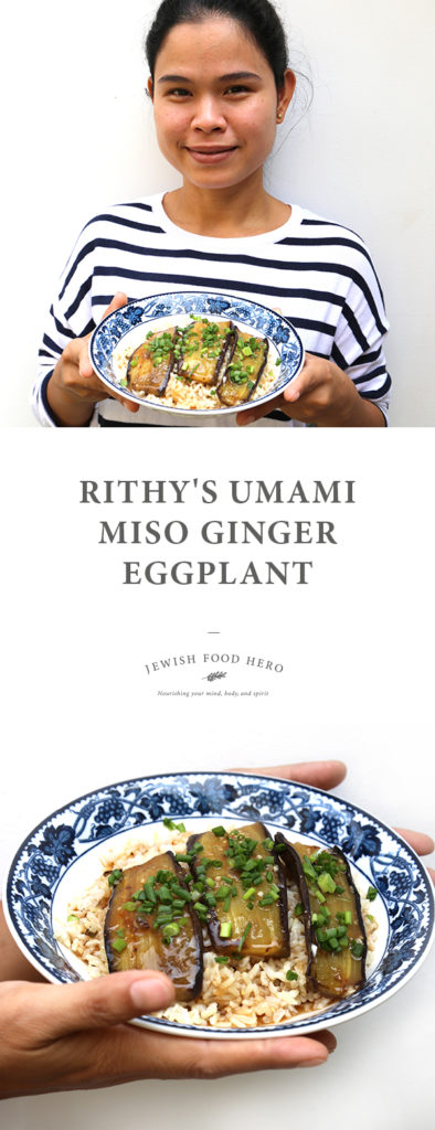 Rithy wearing a striped t-shirt and holding a blue patterned bowl full of brown rice and aubergine topped with herbs