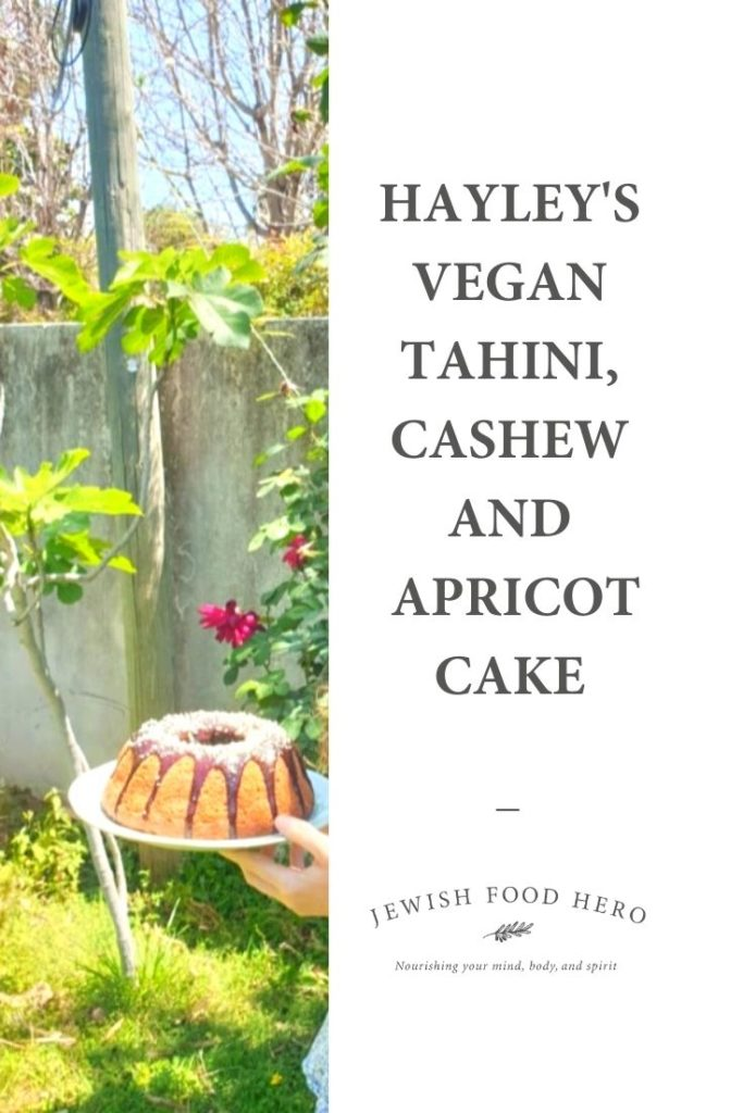 Hayley holding Hayley's Tahini, Cashew and Apricot Cake with a Chocolate Tahini Drizzle in a garden